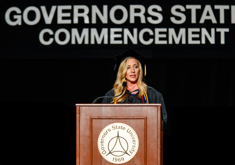 Cristy Gallegos, a GSU alumni, standing at a podium and giving a speech at the 2019 GSU commencement ceremony