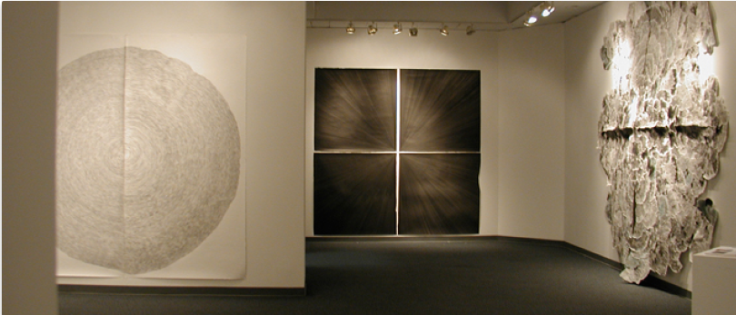 Interior of the Visual Arts Gallery featuring large abstract artwork on the walls