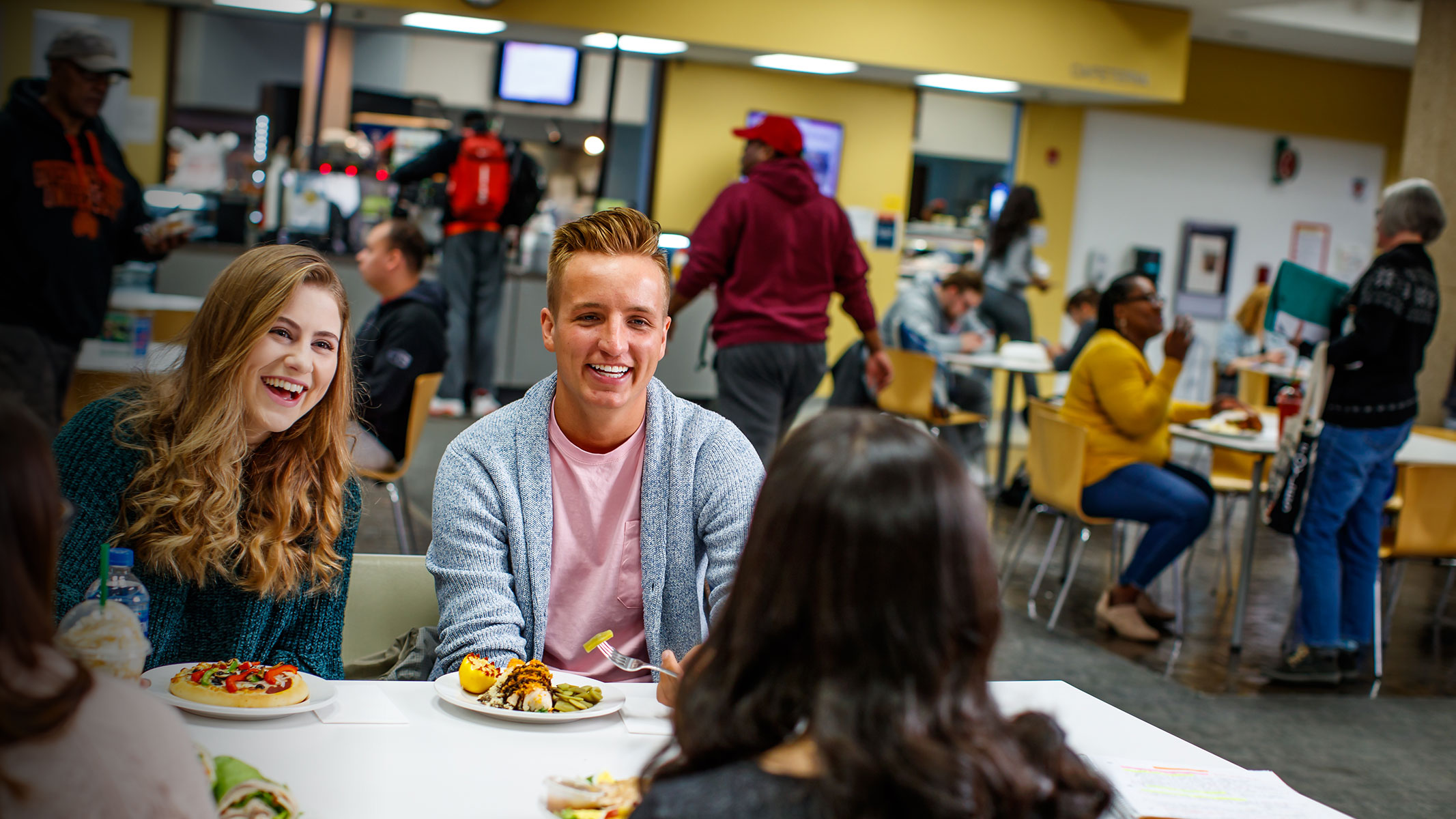 Students smiling in Cafeteria