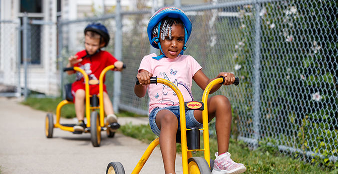 Children riding tricycles