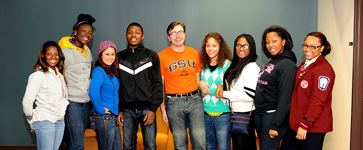 Students and Dr. Rhea posing for picture in recreation area