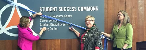 Photo of President Elaine P. Maimon cutting the ribbon in front of the new Student Success Commons.
